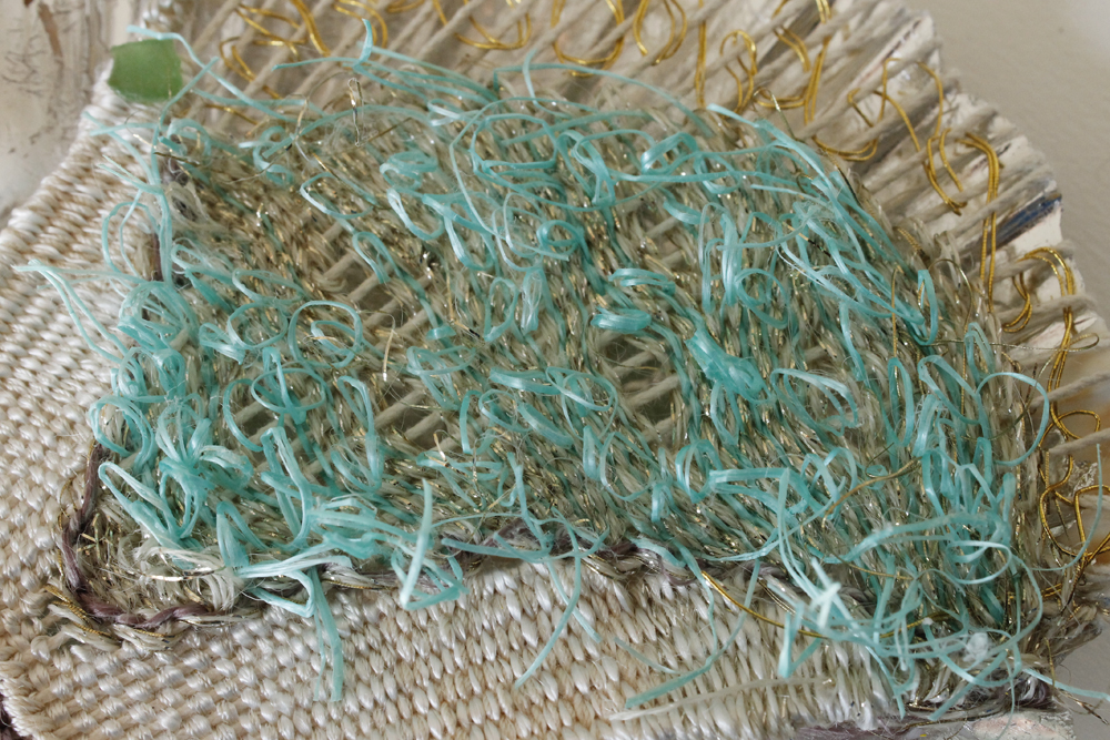 The weaving is made with plastic string from the beach at st Leonard's on sea