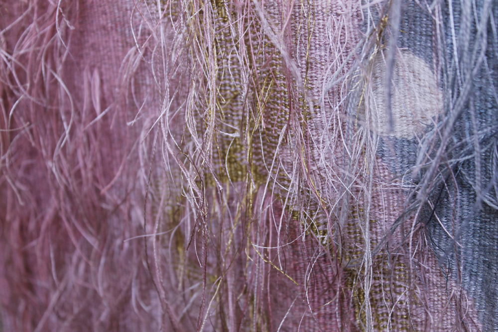 Threads on the back of the shell tapestry