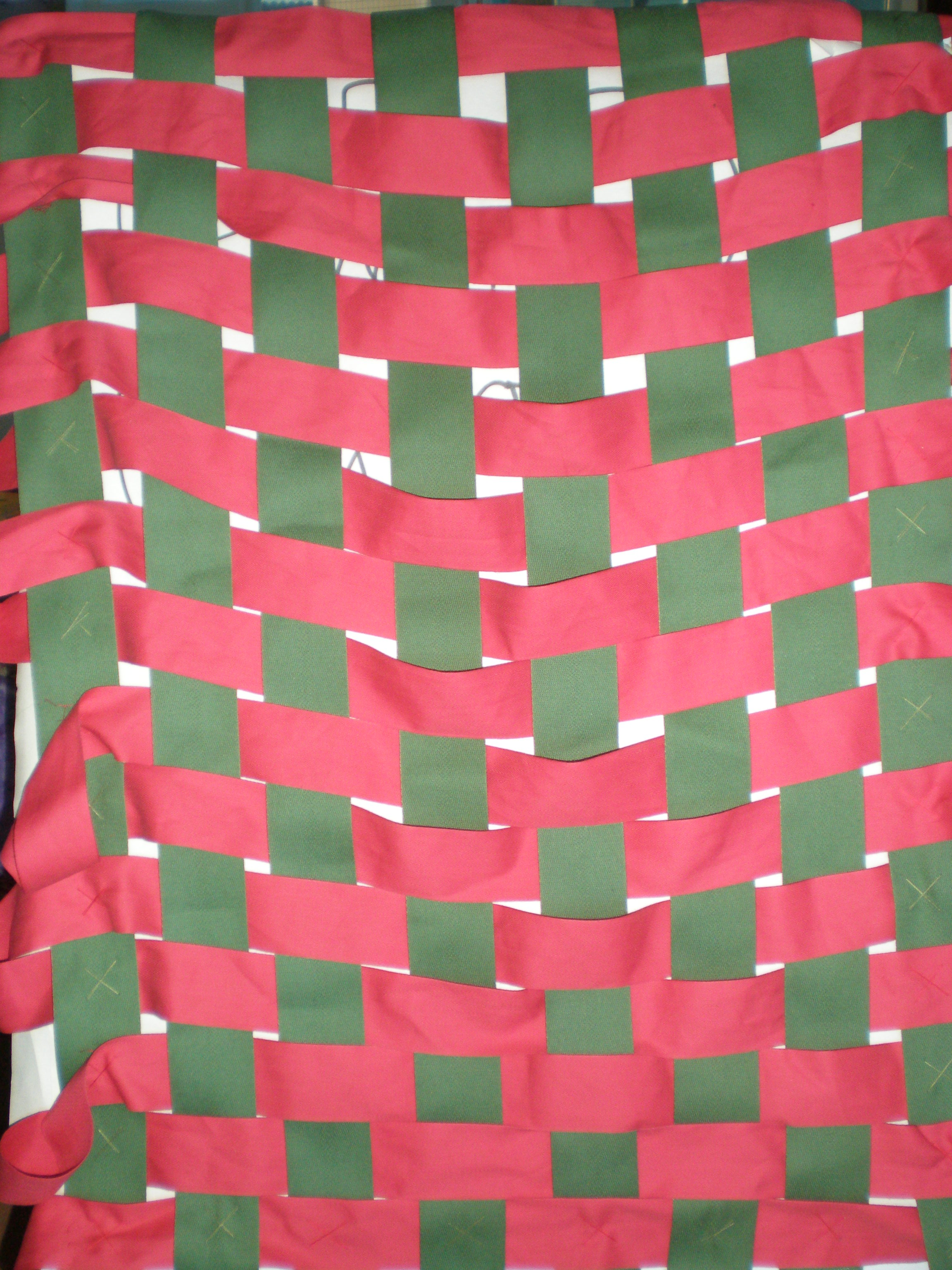 Weaving made with wide tape strips