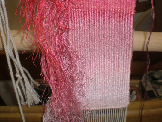 Blush The reds gradually develop across the weave, hiding behind the fringe